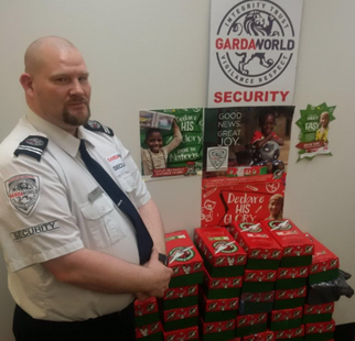 GardaWorld agent showing filled boxes for the Operation Christmas child donations program