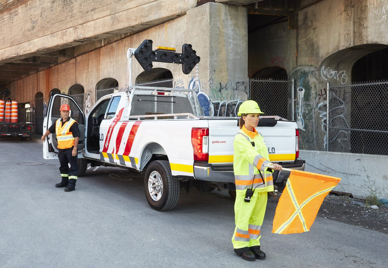 Traffic Control Services - GardaWorld road flagger providing traffic control services