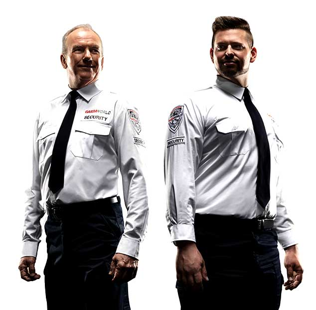 Two male GardaWorld security guards who took on-site training courses