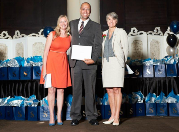 Danielle Weddepohl (Program Coordinator, Investigation – Public and Private Program, Sheridan College), Hildemar Timbo Martins Junior (award recipient), Colleen Arnold (Vice President, National Customer Service Excellence and Operations - Central & Atlantic Canada, GardaWorld)