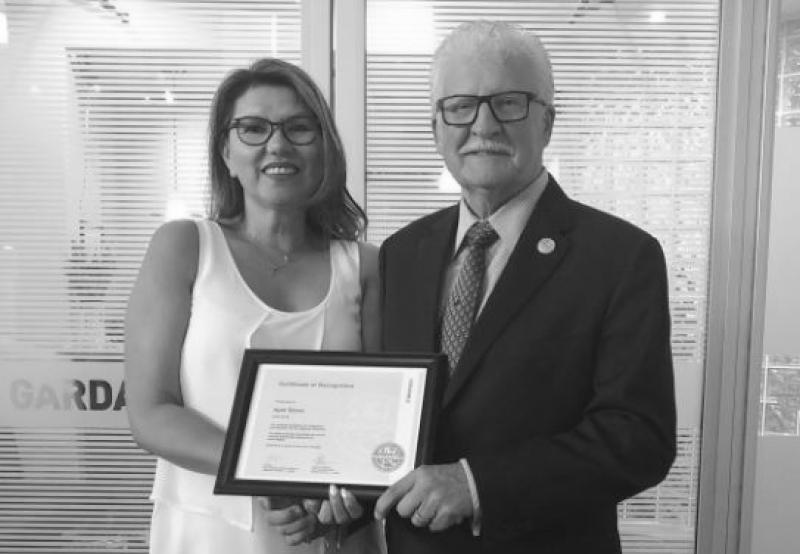 Cy King, Vice President of the Northern Region and Indigenous Relations, presented April Stone, Director of Indigenous Relations and Economic Development, a certificate on behalf of GardaWorld to commend her engagement with Indigenous communities.