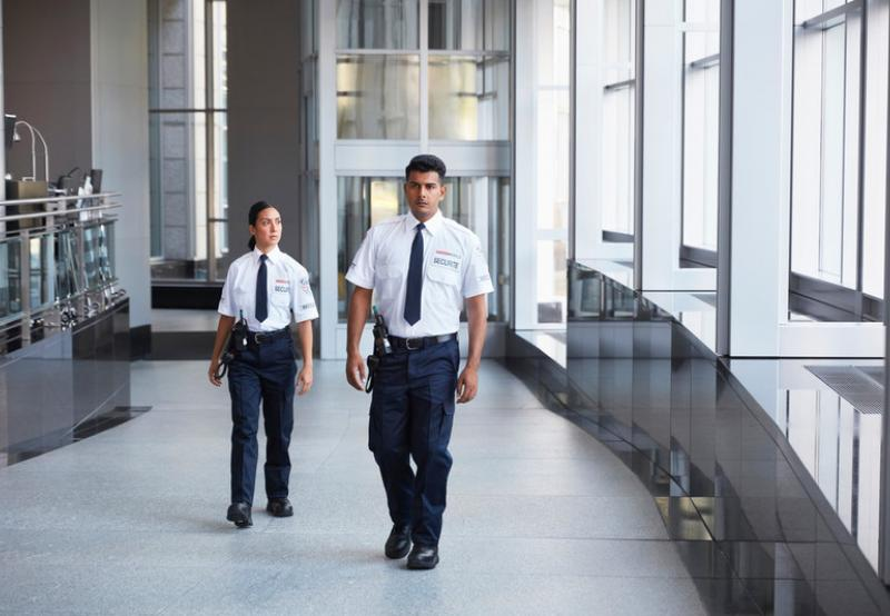 GardaWorld security services guards walking inside a building