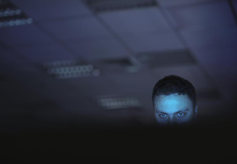 Hacker in a dark office