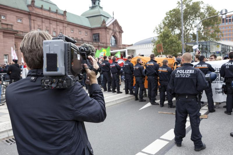 Clashes between far-right protesters and anti-fascist counterprotesters leave several wounded
